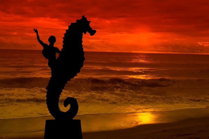 Seahorse sculpture on Los Muertos beach, in sunset Puerto Vallarta, Mexico