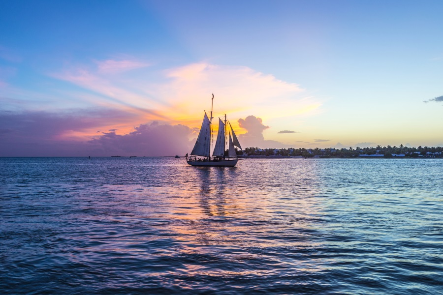Sunset at Key West with sailing boat and bright sky